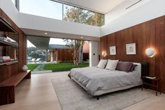This is extraordinarily minimalist for Beverly Hills! I think the bedroom is my favorite, for that exterior wall, wow!
