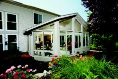 A gable-style all-season -- a bright, sunny place to relax. Sunroom Addition, Patio Enclosures, Sunroom Ideas, Custom Design, Relax, Bright, Building, Places, Outdoor Decor