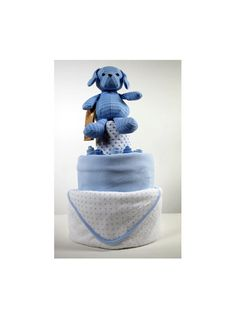 This 3 Tier cake includes:    1x Blue Puppy Plush (0+ years),  1x Hooded Baby Bath Towel,   1x Fleece blanket,  3x Feeding/ Muslin Cloths,   2x Pairs of Scratch Mits,  5x Pairs of socks,  50x Size 1 Pampers Nappies.