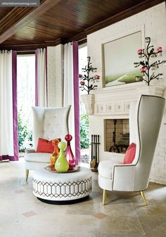 I love over exaggerated tufted wing back chairs & the beautiful details on ottoman