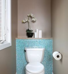 Love how the tile frames the toilet. ♥ Click on the picture to see how this contractor used this blue tile in the rest of the bathroom! #tile #bathroom #homeinspiration