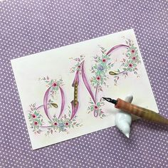 Introducing my Gilded Garden series of letters. I wanted to try something different with my raised gilded letters so I paired it with a… Flourish Calligraphy, Calligraphy Doodles, Islamic Art Calligraphy, Calligraphy Letters, Calligraphy Handwriting, Creative Lettering, Lettering Styles, Lettering Design, Hand Lettering