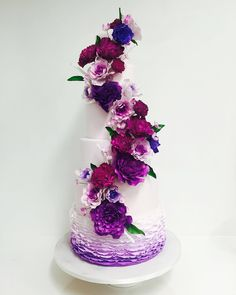 6 tier purple ruffle wedding cake covered in gorgeous sugar flowers! ~ we ❤ this! moncheribridals.com