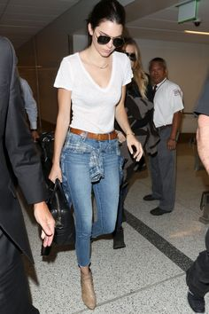 Laving LAX wearing a white t-shirt, cropped jeans and ankle booties - HarpersBAZAAR.com