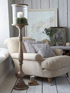 A comfy armchair beside the windo, with the candle lamp. #Welove #DecorIdeas