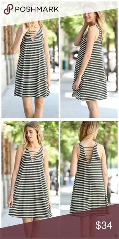 """Striped Olive Ribbed Dress Striped olive ribbed shift A line dress featuring V neck opening. Made of rayon/ spandex blend. Loose fitting. Length approx 37"""". Made in USA  Fits true to size Bchic Dresses Mini"""