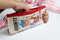 This candy wrapper zipper pouch makes a fun handmade gift for anyone on your list.  Isn't it cute?  For more gift ideas be sure to check out my handmade gift ideas that we have been sharing all month long.  This hot chocolate gift idea makes a perfect last minute gift. Candy Wrapper Zipper Pouch Tutorial Hi all! Alicia here again from Sew What Alicia. I love the holiday season! I...