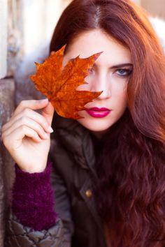 Woman Wearing Black Zip-up Jacket Holding Brown Maple Leaf  Free Stock Photo