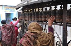 Women turn the prayer wheels in Swayambhunath Stupa where religious ceremonies have been taking place for over 2000 years. Thank you @onthegotours for helping make this such a fun adventure. #travel #nepal #unesco