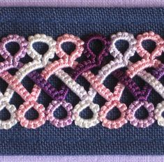 Plaited tatting done with six shuttles.  This looks really cool.