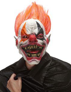 Masque latex clown de l'enfer adulte Halloween : Ce masque de clown en latex représente une tête de clown terrifiant dont la bouche maquillée est fendue d'un sourire glacial.Le nez est peint de rouge et les yeux sont...