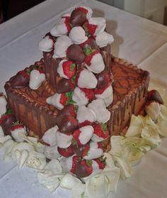 2-tiered grooms cake with white and dark chocolate dipped strawberries and the added benefit of chocolate dripping down the sides~