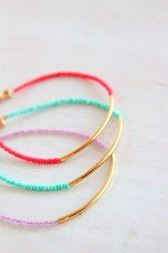 easy to make with some cheap gold bangles + friendship bracelet thread and beads. i friends and friendship bracelets :) Jewelry Accessories, Fashion Accessories, Jewelry Design, Fashion Bracelets, Jewelry Bracelets, Simple Bracelets, Diy Bracelet, Colorful Bracelets, Women's Jewelry
