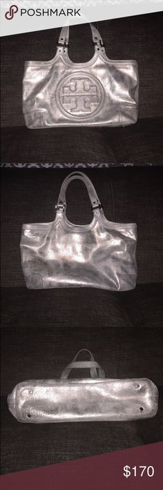 TORY BURCH bombe silver tote bag Tory Burch silver/gray distressed look tote bag. This is a re Posh. I loved the bag but unfortunately it is too small for my liking. I could not zip it up.😢 Size is 17'x 9.5'x5'. Handles have slight wear. Bag itself is in good condition. Some minor markings throughout ( the distressed look) check out all pics. Zippers work properly. Feel free to make a reasonable offer🙌🏻 Tory Burch Bags Totes