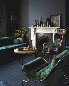 A grey living room can look too boring and impersonal and adding different hues of greens to it, makes a whole lot of difference.