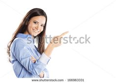 Beautiful young woman pointing to somewhere, isolated over a white background - stock photo