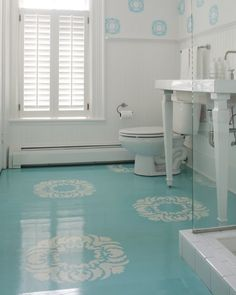 Aqua and white floor stencil. Just lovely. Also, the super shiny gloss coating is perfect for a bathroom setting.