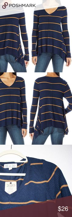"""Navy & Gold Striped Sharkbite Hem Sweater NWT This sweater is extremely flattering and cute! It features contrasting rib knit sleeves and hem with fine knit on the body, a seam down the center that adds texture, a shark bite hemline that drapes beautifully, and an attractive V neckline. The colors are a true dark navy and a golden orangey yellow which PINK ROSE calls """"Tapestry Blue"""" and """"Golden Beet."""" 70% rayon and 30% nylon. I'm happy to provide measurements upon request! Pink Rose Sweaters…"""