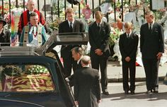 Coffin of Diana, Princess of Wales, placed into hearse at Westminster Abbey following her funeral service, 09-06-1997.  Millions lined route.
