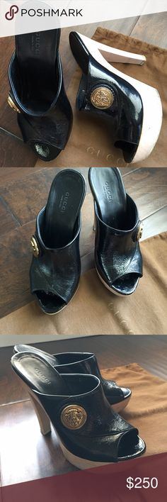 Gucci clog slip on - Size 5.5 / 35.5 EU Gucci natural wood clog 5 inch at back, 1 inch at front with black patent leather top and bottom of the feet.  Gold round logo on the side.  Size - 5.5 Gucci Shoes Mules & Clogs