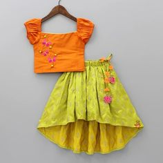 Pre Order: Orange Off -Shoulder Top With Green Up And Down Ghagra Source by Blouses Kids Party Wear Dresses, Kids Dress Wear, Kids Gown, Dresses Kids Girl, Kids Outfits Girls, Girl Outfits, Kids Party Wear Frocks, Designer Dresses For Kids, Fashion Outfits