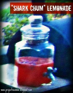 """""""chum lemonade"""": frozen lemonade concentrate, water, small BOX of frozen WHOLE strawberries - 1 box per gallon of drink is plenty. Make the lemonade as directed, and place into a clear drink dispenser.  Then add the box of whole strawberries.  Mix just a little. You can see how red the lemonade got--that was purely from the strawberries; no food dye necessary.  It's DELICIOUS and it looks like there is real bloody chum floating in the lemonade!"""