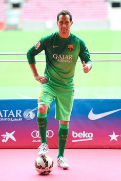 Claudio Bravo poses as a new player for FC Barcelona at the Camp Nou Stadium on July 7, 2014
