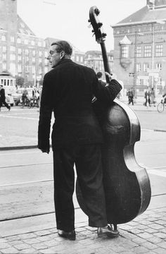"""by Toni Schneiders, """"With a double bass to the townhall place. Rock And Roll, Pictures On String, Guitar Tabs Songs, Art Of Noise, Yamaha Bass, Street Musician, Double Bass, Music Aesthetic, World Photography"""