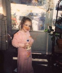 Notice the old lady on the porch outside, she used to live in that house and wait for her husband outside till he. got home from work. Picture from Amy Bruni of ghost hunters, she took this picture of her little sister in the home they grew up in many years ago
