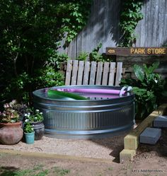 s 15 budget outdoor updates to turn your yard into a relaxing getaway, outdoor furniture, outdoor living, Put a stock tank in your yard for a DIY pool