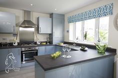 Blue kitchen, new home, 4 bedroom townhouse. turquoise kitchen.