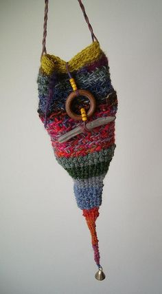 crocheted pixie bag... Pixies are big on making do with bits of yarn and thread they find tangled in bushes and fences. They collect bits of broken jewelry to decorate their homes and clothing too.