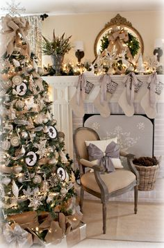 Christmas,tree,socks,fireplace,chair,pillow,white,silver,green,gold,pinecones,ribbon,presents