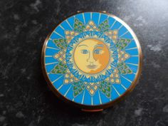Unusual vintage blue/gold   face of the sun  powder compact by stratton