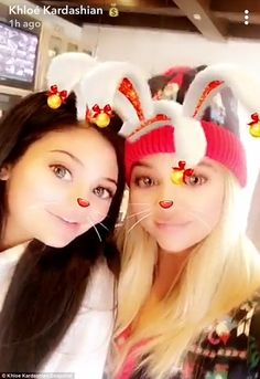 Christmas morning: On Christmas morning, the Kardashian family took to Snapchat to capture images of the family ready to open gifts; here is Khloe, right, with Kylie, left