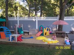 toddler play area. I like the idea of have the play area in dirt and surrounded by grass.