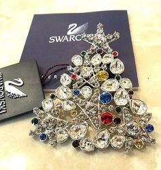 Swarovski Crystal PLATINUM $135 Rockefeller Christmas Tree Annual Pin 06 1515849
