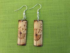 Bamboo dandelion earrings by DEvelins on Etsy https://www.etsy.com/listing/192323486/bamboo-dandelion-earrings