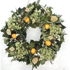 Opulent and sophisticated design of dried flowers and leaves with faux lemons.Features:Limelight hydrangea creates a deluxe f...