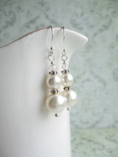 Look At Her - These lovely earrings are made with white Swarovski pearls and clear bicone Swarovski crystals. They are about 3,5cm in length (1,4). The metal components are solid sterling silver 925. These earrings are a perfect gift for you or a friend and can be worn at any occasion <3 <3 <3    Every item will be packaged in a beautiful jewelry bag and ready for gifting!    Need more than one pair of these? It´s usually no problem! Just send me a convo, I´d love to make a custom listing…