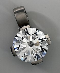 The American Star Diamond began life as an unnamed 14.89-carat D-color, Flawless-clarity round brilliant. It was bought in 1999 by the EightStar Co. of California, with the intent of a recutting. The plan was to prove, on a large scale, that the EightStar approach brings otherwise unattainable sculptural & optical perfection to the round brilliant. The gem appeared in the February 2005 edition of Robb Report magazine & is arguably the finest cut round natural blue diamond in the world…