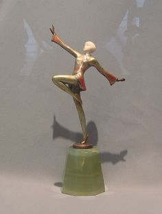 A lovely Art Deco bronze and ivory dancing girl by one of the most eminent artists of the period Josef Lorenzl (1892-1950). She has a beautifully carved face and her cold painting is in entirely original condition. She is signed in the bronze by one of the many signatures used by Lorenzl ( Renz). She stands upon a well shaped green onyx base. Circa 1930.