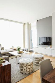El gris y la madera se han convertido en la nueva pareja de moda, el resultado una decoración elegante y muy acogedora.