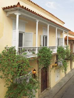 In the walled section of the Spanish Colonial city of Cartagena, Colombia, one of sixteen historic casas grandes. Home's original 18th-c. facade with new roof tiles in Colonial style. - Veranda.com