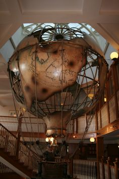 Around the World in 80 days feature which dominates the staircase in the hotel reception climbing up 3 floors! Around The World In 80 Days, Around The Worlds, Hotel Reception, Climbing, Floors, Steampunk, Home Tiles, Flats, Mountaineering