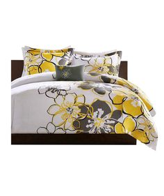 Go for this modern take on the tried-and-true floral motif. The dash of yellow adds just enough brightness and life to a boring dorm room, but the gray and black outlines make it sophisticated and grown-up enough for a college student. The set comes with a comforter, a sham, and a decorative pillow.