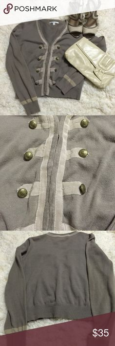 Feminine military style cardi Taupe sweater w light tan stripe at sleeve, and same color grosgrain ribbon lining front and around neck. Military double breasted buttons down front. Eyelet closure. Doesn't fit like a typical CAbi M- fits S better CAbi Sweaters Cardigans