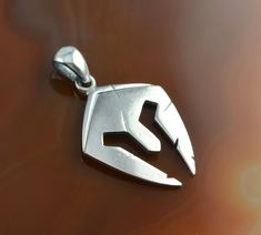 A silver pendant representing the helmet of Leonidas - brave, fearless king of Sparta, one of the greatest heroes in the history of ancient Greece - a symbol of heroism and gallant sacrifice.