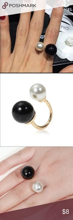 Dbl Black/pearl adjustable gold ring A modern chic look.  Black and white pearl like beads edge this gold tone ring that is adjustable since it isn't closed all the way.  Has an open look from the top and is easily matched to everyday wardrobe items, and on trend!                                                                Shop with confidence.                                            Suggested User                                                   Next day shipping…