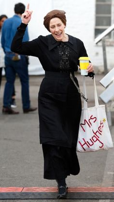 Actress Phyllis Logan hurried to set with her hair in curlers, carrying a coffee and a 'Mrs Hughes' tote